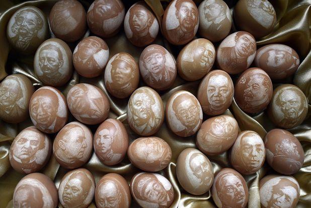 Guan Qingsheng carves faces onto eggshells, 6/2/15