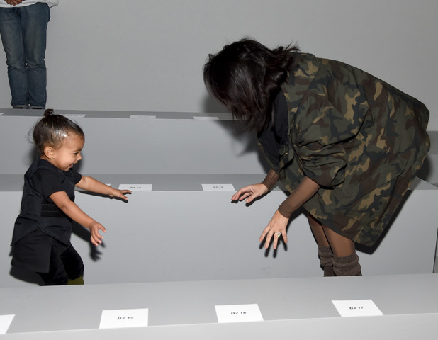NEW YORK, NY - FEBRUARY 12: (L-R) Beyonce, Kim Kardashian with daughter North and Anna Wintour attend the adidas Originals x Kanye West YEEZY SEASON 1 fashion show during New York Fashion Week Fall 2015 at Skylight Clarkson Sq on February 12, 2015 in New York City.