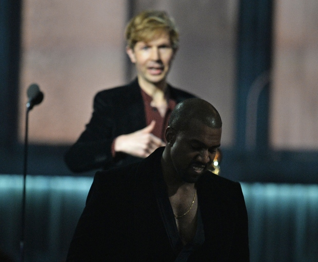 Beck reacts as Kanye West leaves the stage at the 57th Annual Grammy Awards in Los Angeles February 8, 2015.