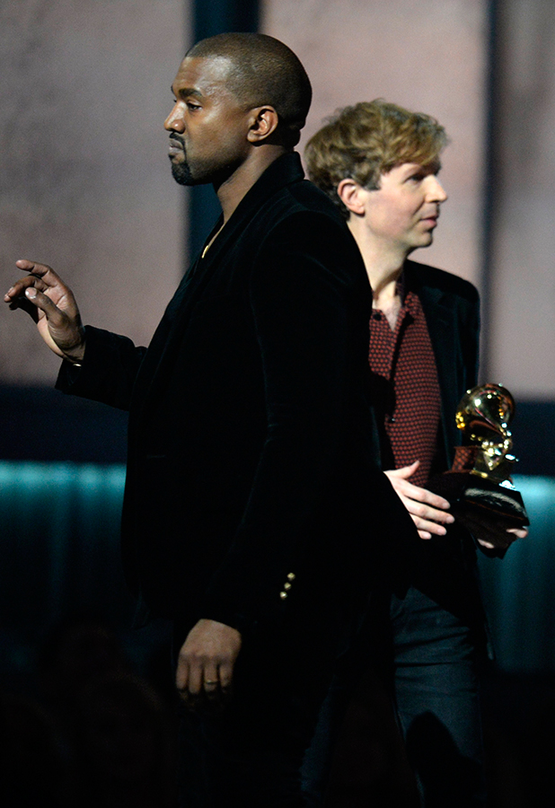 Winner for Album Of The Year Beck reacts as Kanye West appears on stage at the 57th Annual Grammy Awards in Los Angeles February 8, 2015. AFP PHOTO / ROBYN BECK (Photo credit should read ROBYN BECK/AFP/Getty Images)