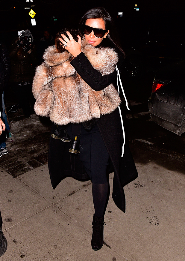 Kim Kardashian and North West (L) seen on the streets of Manhattan on February 11, 2015 in New York City.