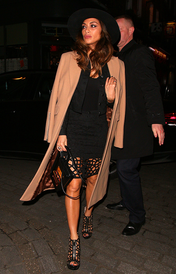 Nicole Scherzinger exits the Palladium theatre after her Cats performance on February 7, 2015 in London, England.