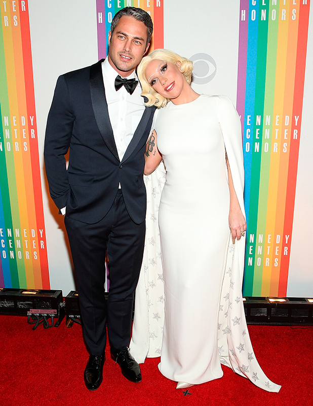Taylor Kinney and Lady Gaga arrive at the 37th Annual Kennedy Center Honors at the John F. Kennedy Center for the Performing Arts on December 7, 2014 in Washington, DC.