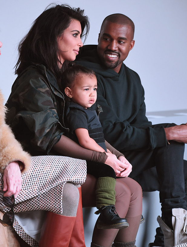 Kim Kardashian, North West and Kanye West attend the adidas show during Mercedes-Benz Fashion Week Fall 2015 at Skylight Clarkson SQ. on February 12, 2015 in New York City.