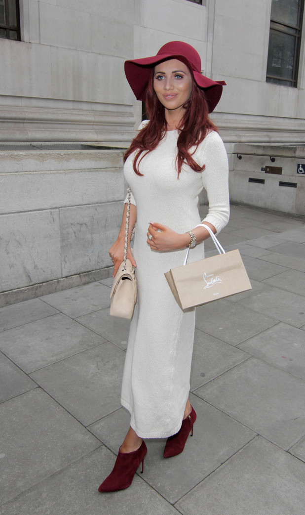 Amy Childs steps out in chic high street look at London Fashion Week yesterday (24 February)