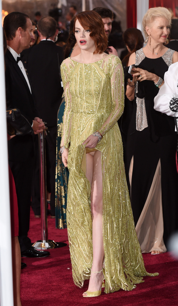 Emma Stone flashes her underwear in revealing dress at the Oscars (22 February)