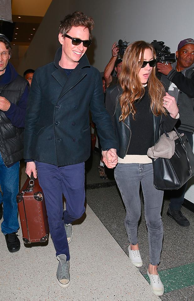 Oscar winner Eddie Redmayne arrives at Los Angeles International Airport to catch a flight with wife Hannah Bagshawe, 23 February 2015