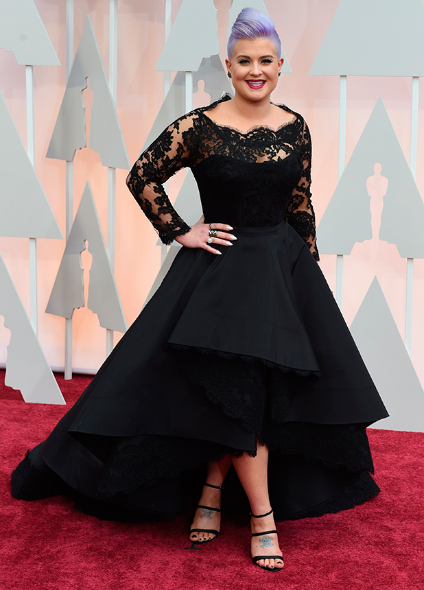 Kelly Osbourne arrives on the red carpet for the 87th Oscars February 22, 2015 in Hollywood, California.