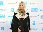 Laura Whitmore rocks biker chic as she presents at charity event