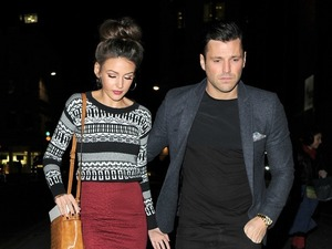 Mark Wright keeps protective arm around Michelle Keegan in London