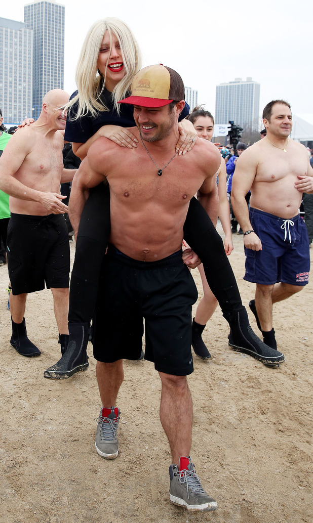 Taylor Kinney and Lady Gaga participates in the Chicago Polar Plunge 2015 at North Avenue Beach on March 1, 2015 in Chicago, Illinois.