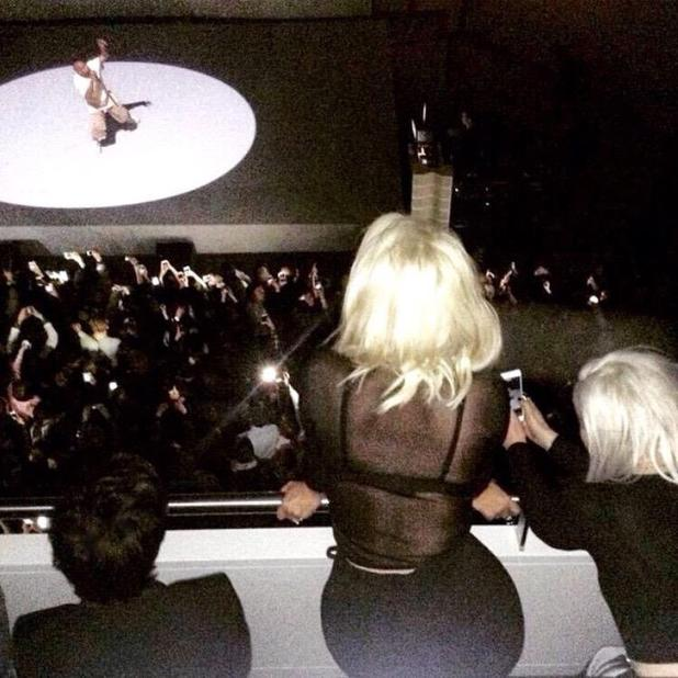 Kim Kardashian shares a picture of herself enjoying a Kanye West gig in Paris, 7 March 2015