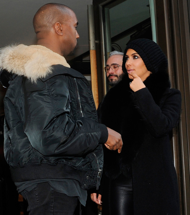 Kim Kardashian West and Kanye West leave the 'Lanvin' store on March 5, 2015 in Paris, France.