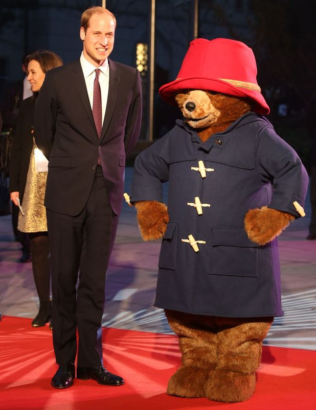 Prince William meets an entertainer dressed in a costume of Paddington Bear on the red carpet for the 'Paddington' film premiere 3 Mar 2015