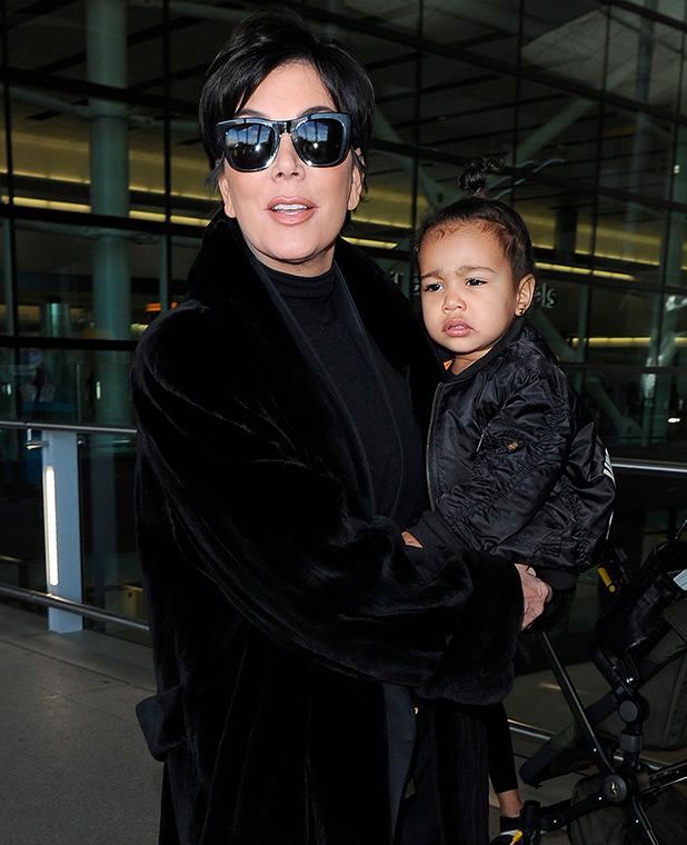 Kris Jenner arrives at Heathrow Airport carrying baby North West, 2 March 2015