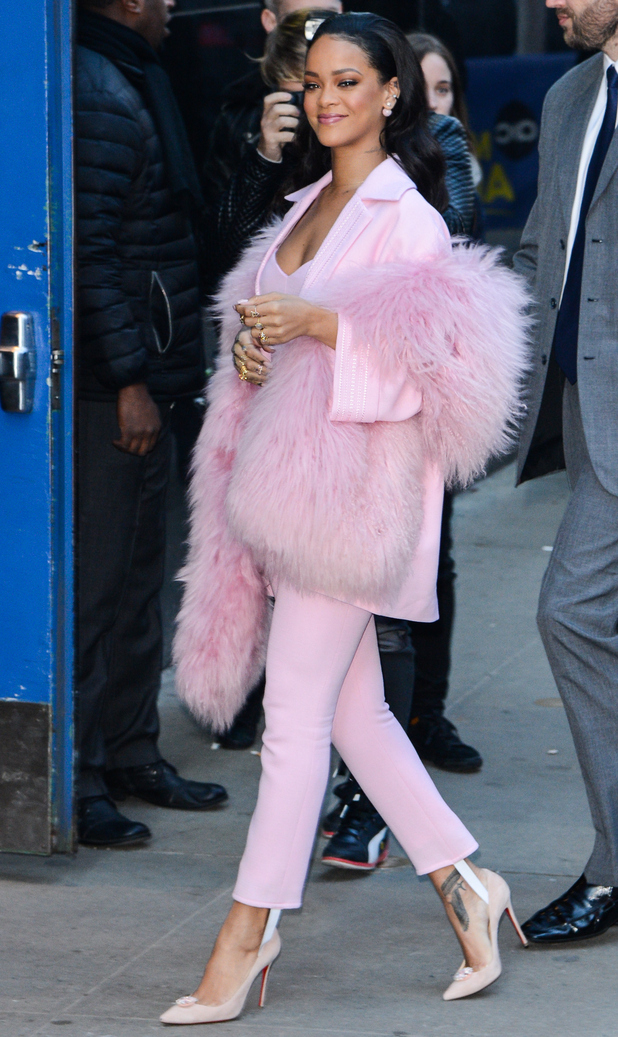 Rihanna enters the Good Morning America taping at the ABC Times Square Studios on March 13, 2015 in New York City.
