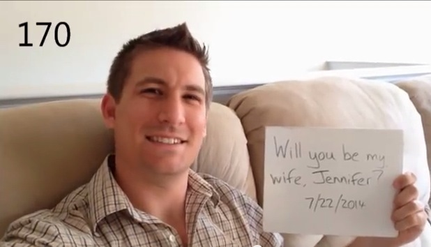 Dean Smith holding proposal whiteboard to camera for Jennifer Kessel
