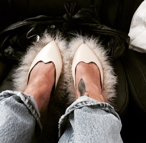 Rihanna wears fluffy-trimmed shoes in Paris - 10 March 2015.