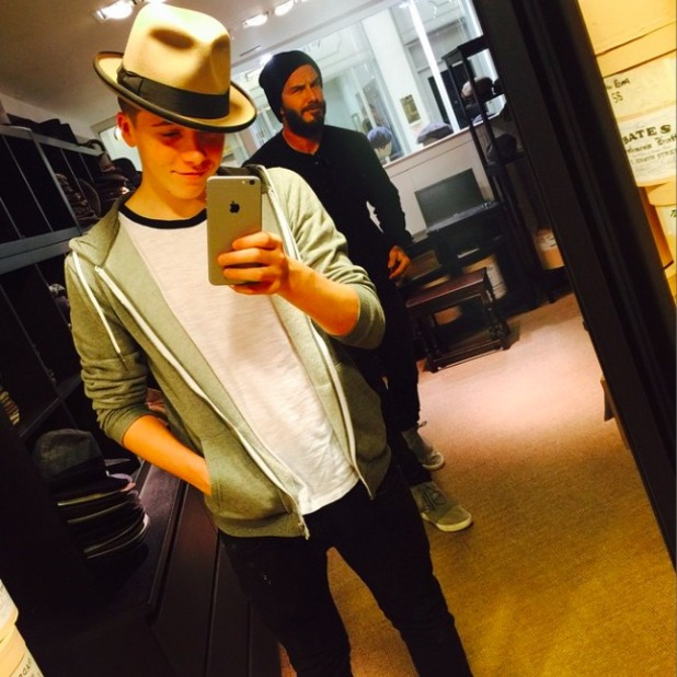 Brooklyn Beckham gets photobombed by his famous dad David, 14 March 2015