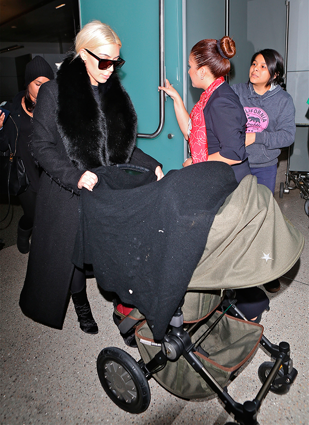 Kim Kardashian and North West seen at LAX on March 12, 2015 in Los Angeles, California.
