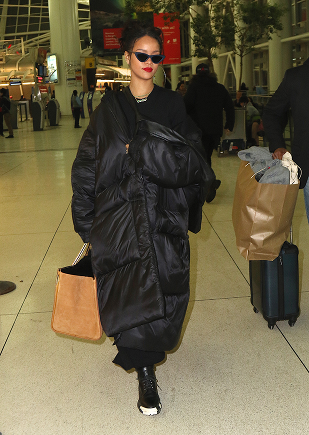 Rihanna arrives at JFK airport as she heads to Paris on March 07, 2015 in New York, New York.