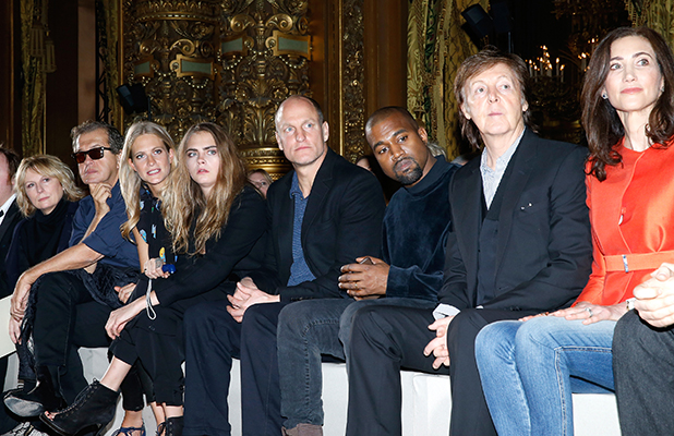 Mario Testino, Poppy Delevingne, Cara Delevingne, Woody Harrelson, Kanye West, Paul McCartney, his wife Nancy Shevell and Husband of Stella, Alasdhair Willis attend the Stella McCartney show as part of the Paris Fashion Week Womenswear Fall/Winter 2015/2016 on March 9, 2015 in Paris, France. (Photo by Bertrand Rindoff Petroff/Getty Images)