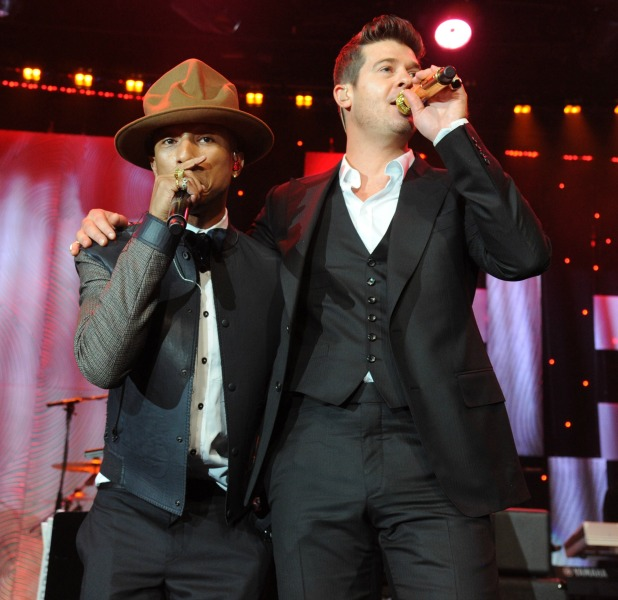 Pharrell Williams and Robin Thicke perform onstage during the 56th annual GRAMMY Awards Pre-GRAMMY Gala and Salute to Industry Icons honoring Lucian Grainge at The Beverly Hilton on January 25, 2014 in Los Angeles, California.
