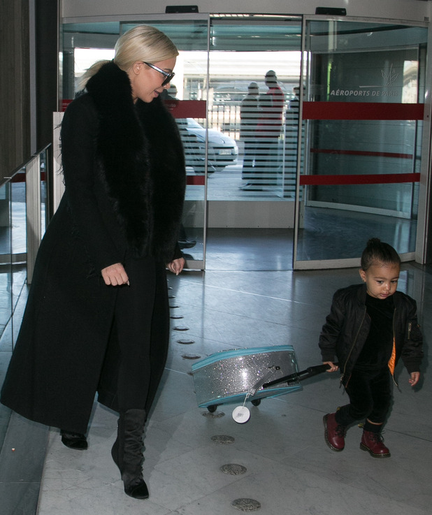 Kim Kardashian West and North West Sighting at Charles-de-Gaulle Airport with North strolling her Frozen suitcase