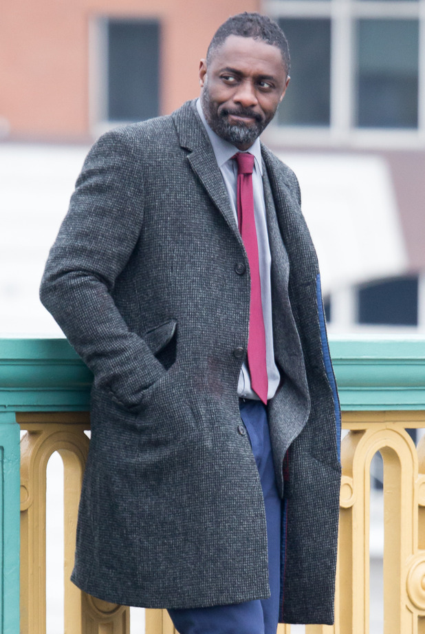 Idris Elba is seen with a hand injury whilst filming 'Luther' on Southwark Bridge - 03/19/2015 London, United Kingdom