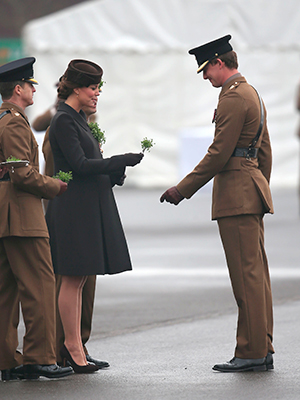 Catherine, Duchess of Cambridge presents shamrock to the Irish Guards during the St Patrick's Day parade at Mons Barracks, 17 March 2015