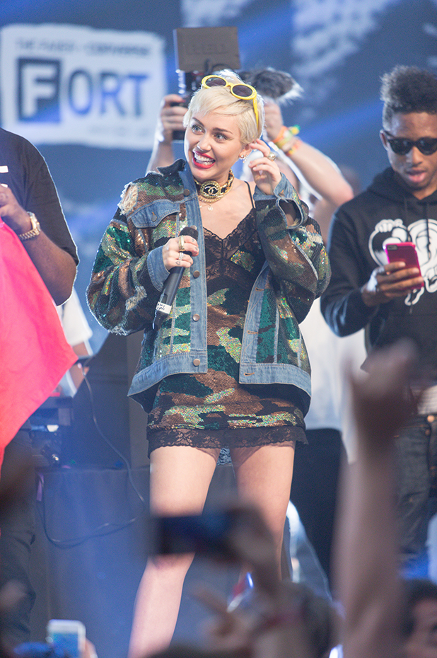 Miley Cyrus performs onstage at The FADER FORT Presented by Converse during SXSW on March 19, 2015 in Austin, Texas. (Photo by Roger Kisby/Getty Images)