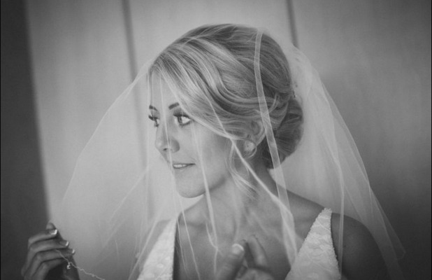 Black and white bride in her dress pauses for thought before walking down the aisle