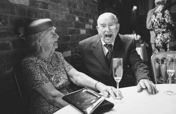Family members enjoy the wedding speeches