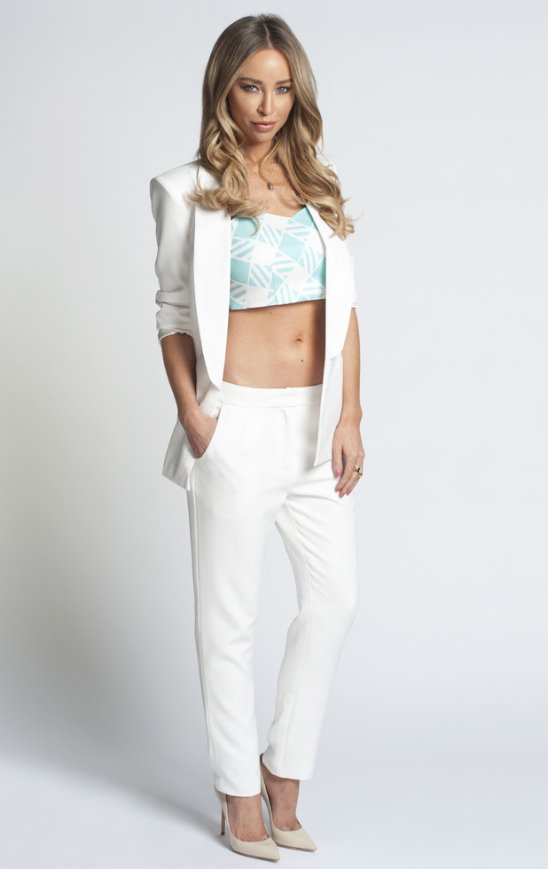 Lauren Pope wearing white blazer and trousers from In The Style SS15 collection