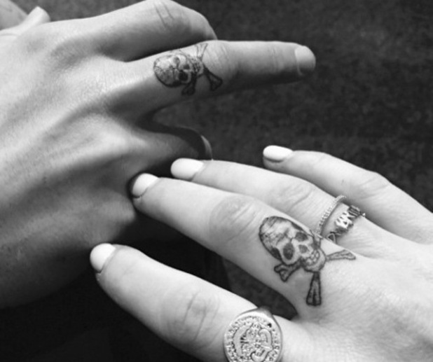 Ellie Goulding and Dougie Poynter get matching skull tattoos on their fingers - 30 March 2015.