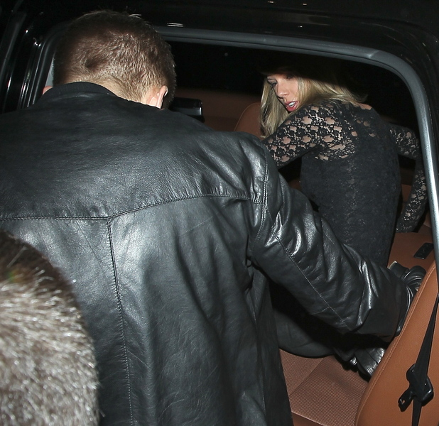 Taylor Swift and Calvin Harris hold hands as they sneak out of the back door of The Troubadour club after watching rock band Haim perform in Hollywood, 2 April 2015