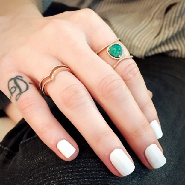 Whitney Port shows off the start of her half-moon manicure, by Stephanie Stone, 26 March 2015