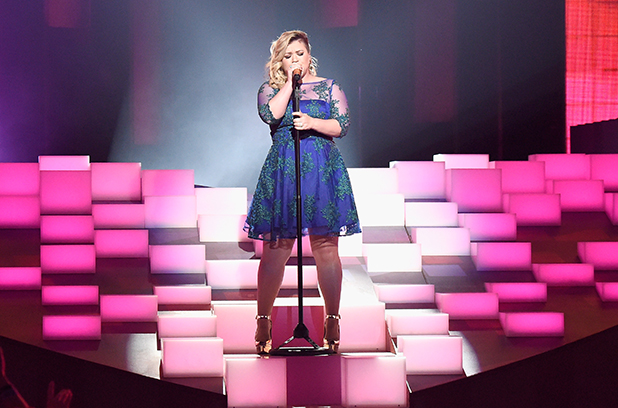 Kelly Clarkson performs 'Heartbeat Song' onstage during the 2015 iHeartRadio Music Awards which broadcasted live on NBC from The Shrine Auditorium on March 29, 2015 in Los Angeles, California.
