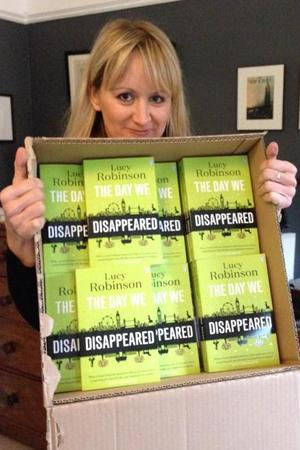 Author Lucy Robinson posing with her new book - The Day We Disappeared - 2 April 2015.