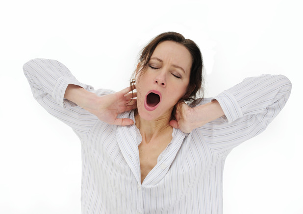 Woman yawning - not being able to sleep is one of the top 10 things we worry about