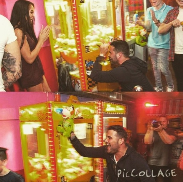 Ricky Rayment wins a teddy bear from a claw machine for girlfriend Marnie Simpson - 9 April 2015.