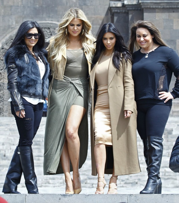 Kim Kardashian (2ndR) and her sister Khloe (2ndL) pose for pictures at a park in Yerevan on April 9, 2015.