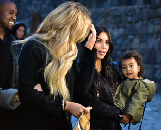 Kim Kardashian (R) with her rapper husband Kanye West (L) and their daughter North on April 9, 2015 visit the Geghard Monastery in Armenia
