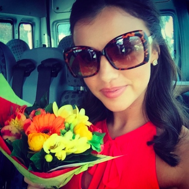 Lucy Mecklenburgh is chuffed when boyfriend Louis Smith gives her his flowers from the medal presentation at the Euros 2015, 18 April 2015