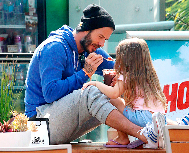 David Beckham and Harper Beckham eating a fruit bowl in LA 13 Apr 2015