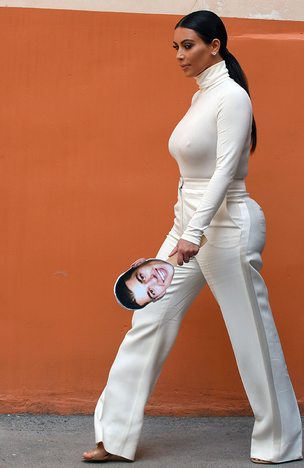 Kim Kardashian walks in a street in Yerevan on April 12, 2015, during her first visit to Armenia to celebrate her family's roots. 12 April 2015