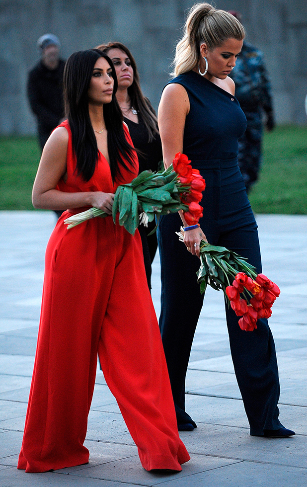 Kim Kardashian (L) and her sister Khloe (R) visit the genocide memorial, which commemorates the 1915 mass killing of Armenians in the Ottoman Empire, in Yerevan on April 10, 2015.