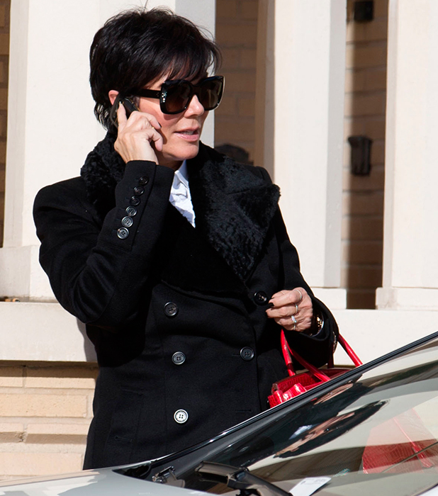 Kris Jenner chats on her mobile phone after shopping at Barneys New York in Beverly Hills, 2013