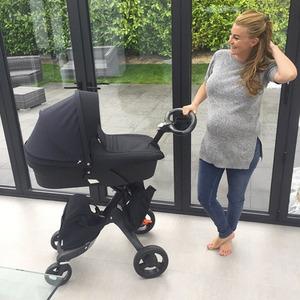 Pregnant Billi Mucklow takes delivery of new pram, April 2015
