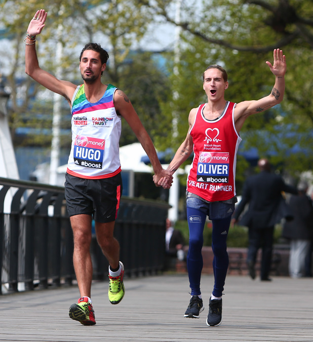 Hugo Taylor, Oliver Proudlock pose for the 35th London Marathon photo call at the Tower Hotel - 24 April 2015.